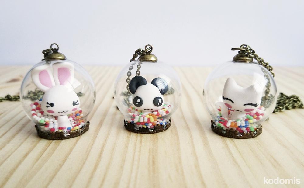 Colgante bola de cristal kawaii de conejo, panda y gato